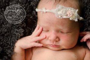 Gatineau-Newborn-Photography-charcoal grey fluff stuffer baby rustic chic baby tieback rosette flower sari silk hand on face eyelashes lips moss-Pure-Natural-Timeless