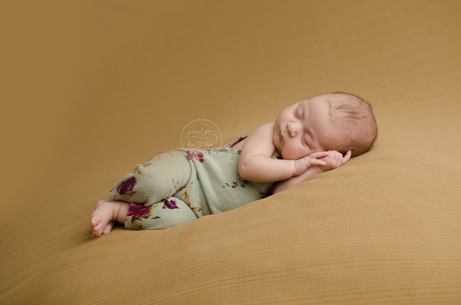 Athena-Newborn-Photography-Session-Ottawa-Baby-Photographer-beige-caramel-backdrop-floral-upcycled-romper-daddymackdesigns-side-laying 7 weeks new