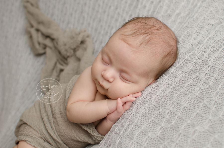 7 weeks new, Athena-Newborn-Photography-Session-Ottawa-Baby-Photographer-grey-knit-backdrop-dolly-priss-cheesecloth-wrap-side-laying-crop